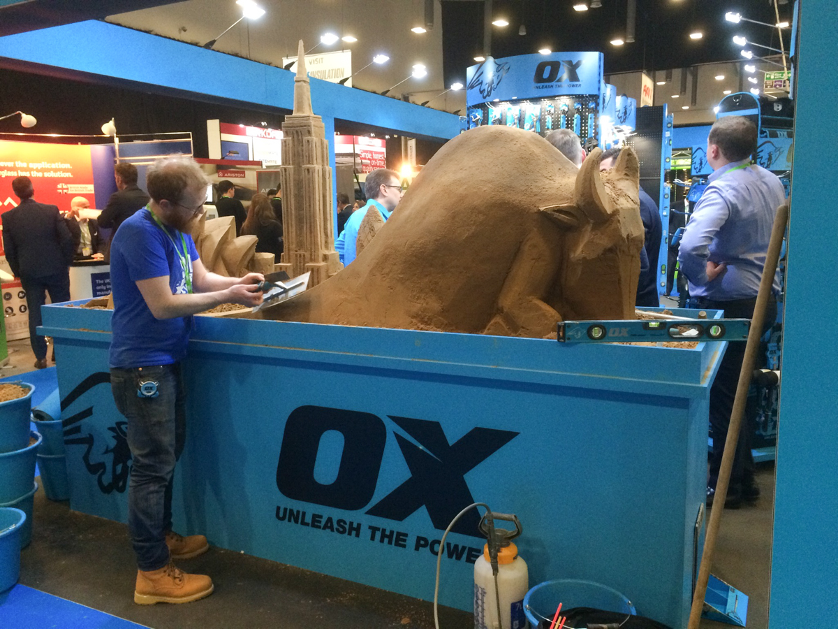 UK sand sculptor Jamie Wardley sculpting live at the trade show event