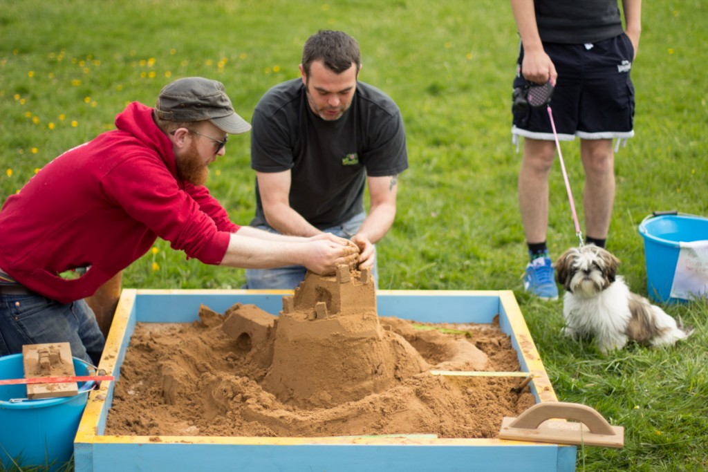 Jamie Wardley teaching the tricks of the trade in the sand sculpture workshop