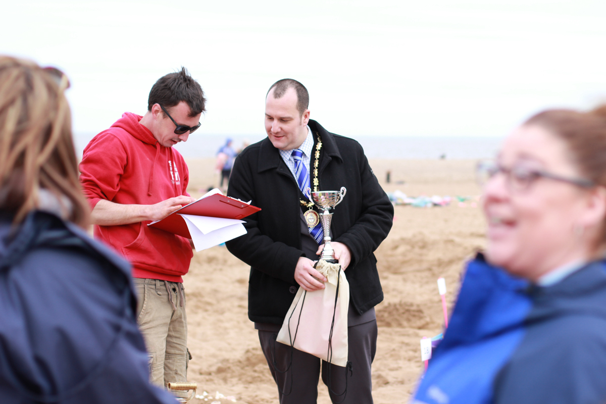 Tom and the Mayor announcing the winners of the sand sculpture competition