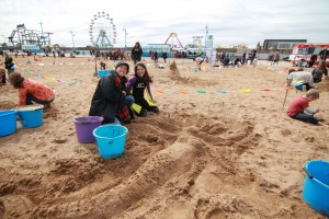 Sand sculpture competition winners with their mermaid