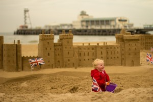 Florence looking pleased with herself with the Windsor Castle sand sculpture to celebrate the Queen's 90th Birthday
