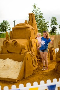 Yorkshire based sand sculptor Claire Jamieson with Bob the Builder sand sculpture, at beach east stratford, by Sand In Your Eye