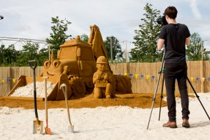 Photographer photographs The Bob the builder sand sculpture on the city beach in Stratford