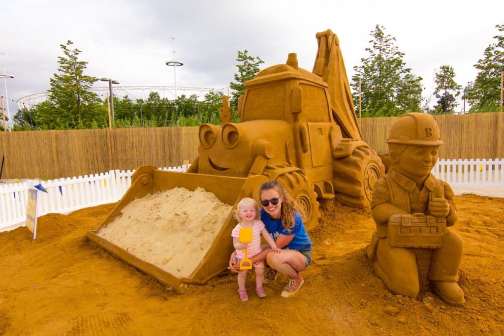 A family of sand sculptors. Claire Jamieson and Florence add the final touches to the sand sculpture