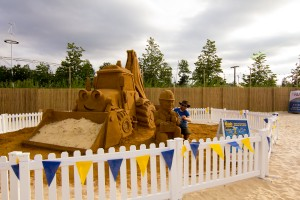 Yorkshire based sand artist, Jamie Wardley with his sand sculpture at Beach East