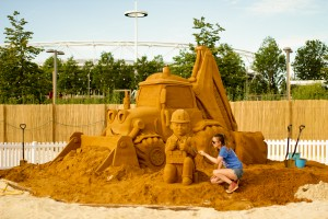 Claire Jamieson with Bob the Builder sand sculpture, at beach east stratford, by Sand In Your Eye