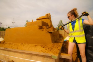 Claire Jamieson begins work on the sand sculpture at an urban beach event in the UK