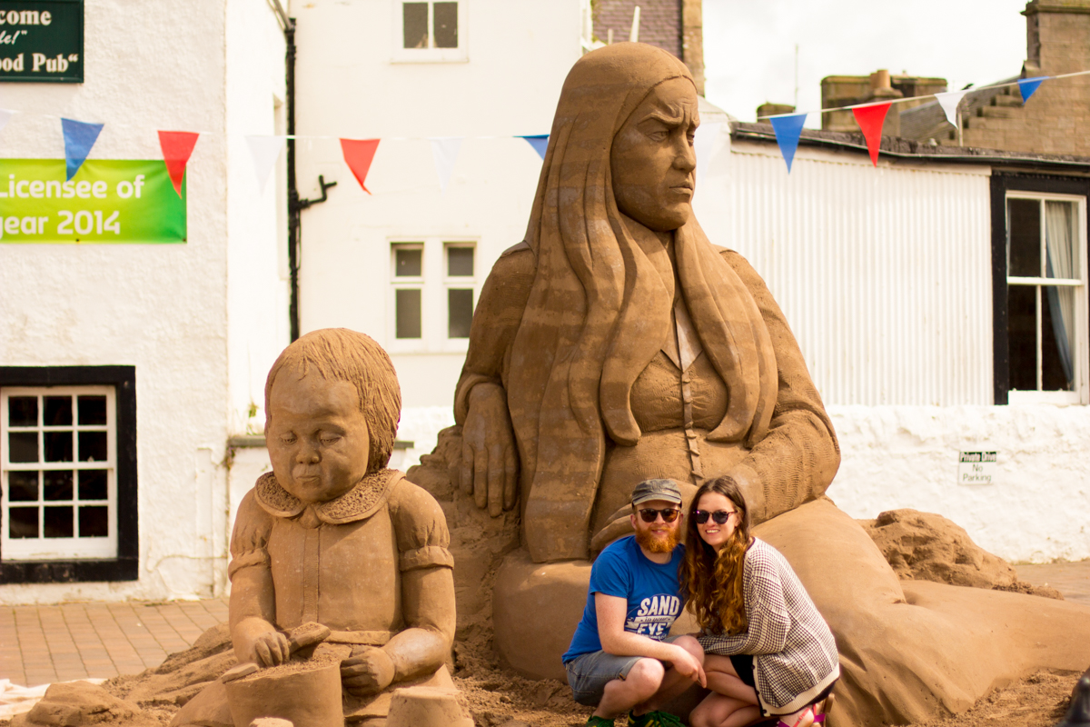 Sand sculptors Claire Jamieson and Jamie Wardley creating a sculpture to commemorate the Battle of the Somme