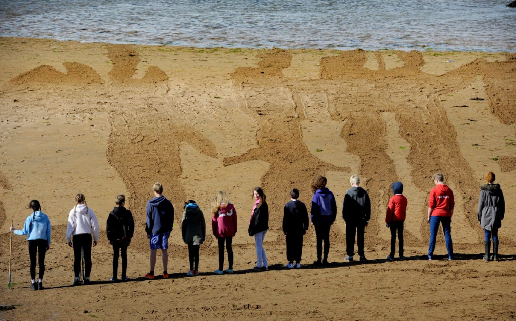 anamorphic sand drawing in Elie, Scotland commemorating the Battle of the Somme