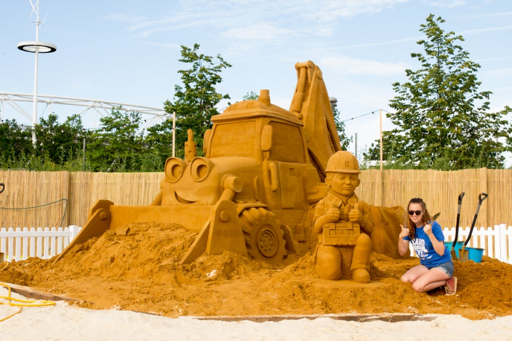 Sand sculptor Claire Jamieson with Bob the Builder sand sculpture, at beach east stratford, by Sand In Your Eye