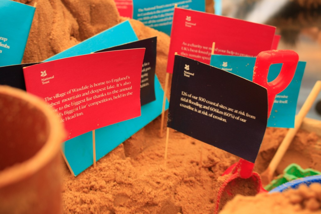 Sand Sculpture with National Trust Facts on Flags