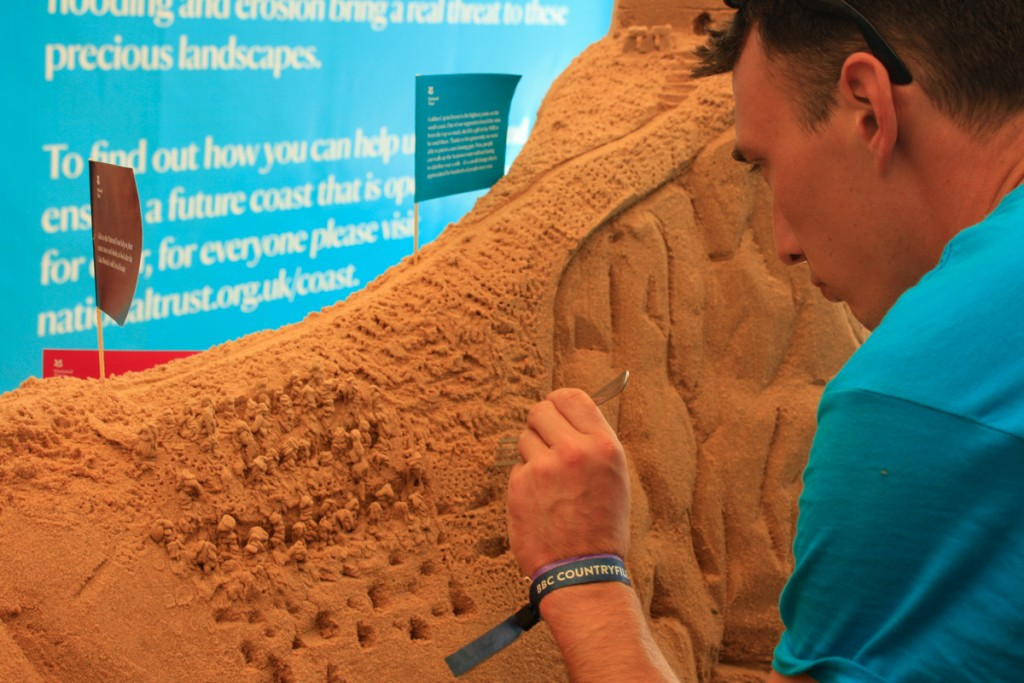 Tom working on the sand sculpture at Countryfile Live Festival with the National Trust