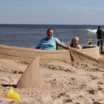 Interactive beach sand sculpture