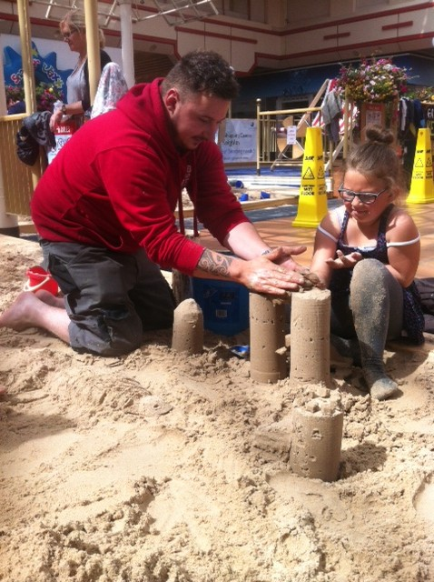 James showing how to make a sandcastle