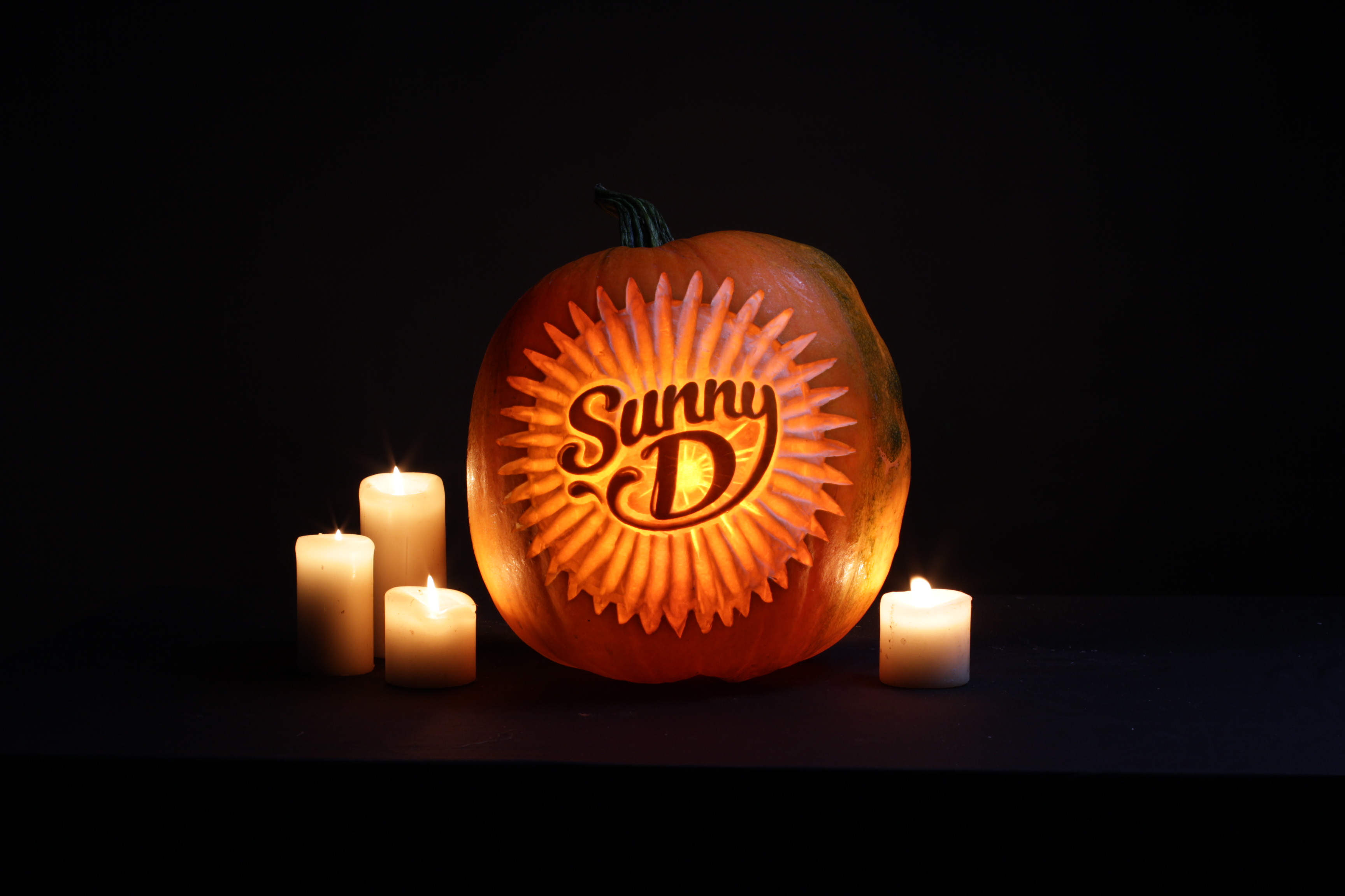 Sand In Your Eye pumpkin carvers create logo pumpkin carving