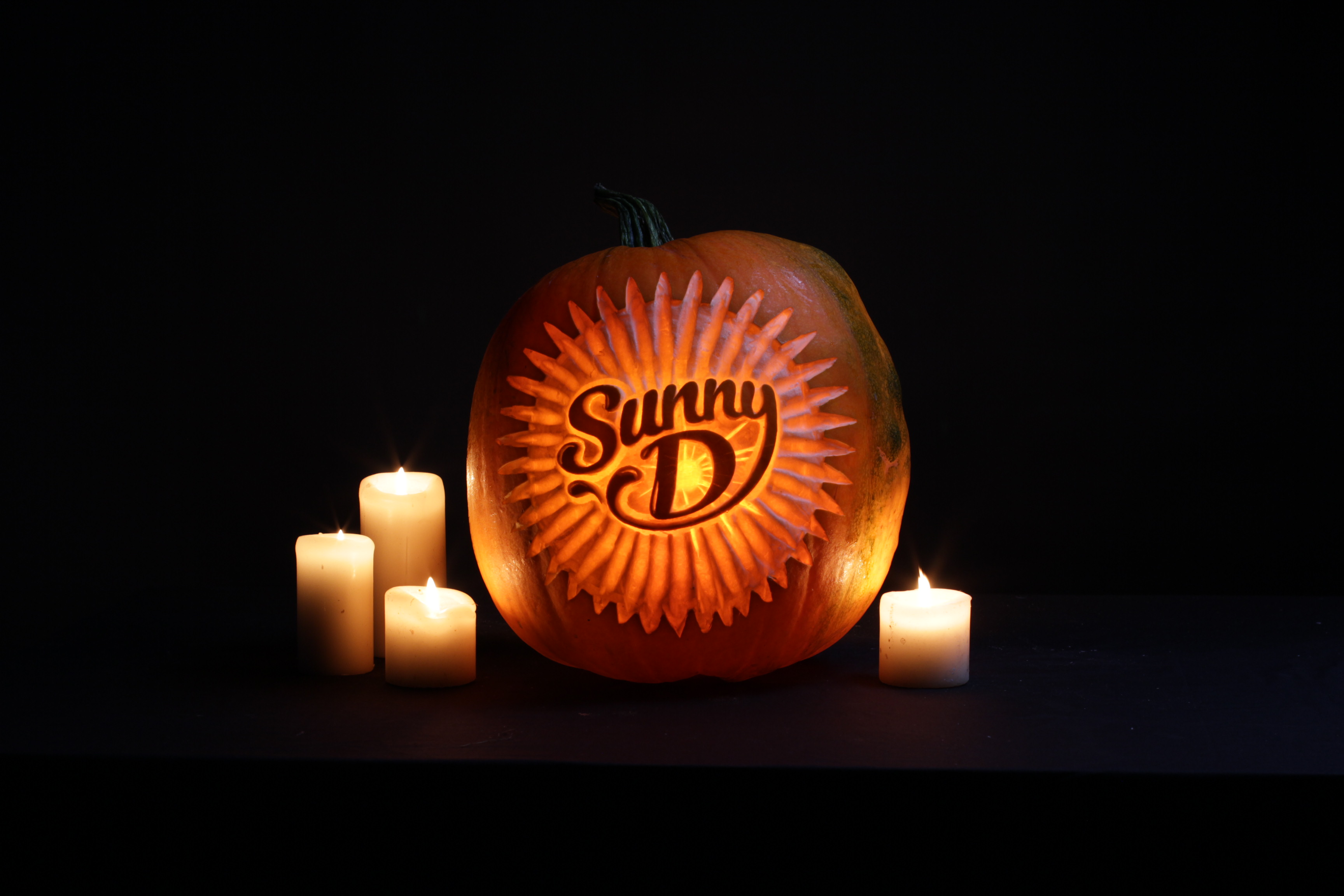 Pumpkin carvers create logos and branding into pumpkins