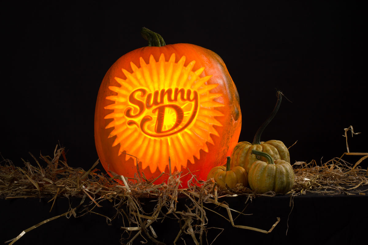 The precise art of carving logos into pumpkins