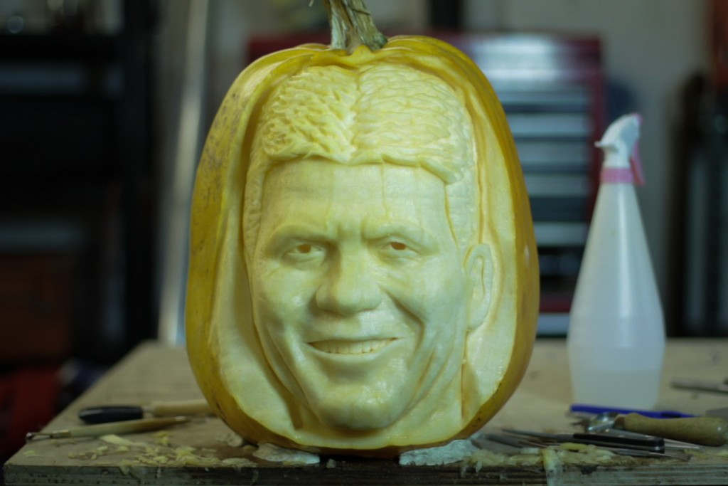 Simon Cowell pumpkin carving progress
