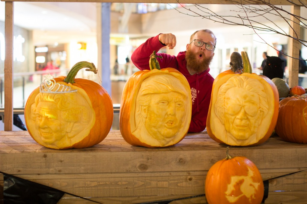 Professional pumpkin carver Jamie Wardley with his celebrity pumpkins