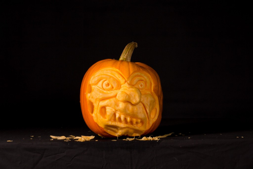 Pumpkin carvers create scary faces