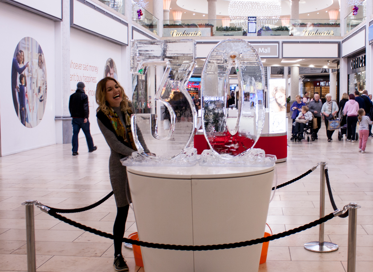 Chelsea posing with the ice sculpture