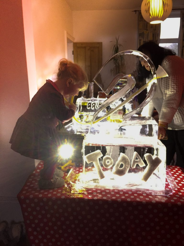 Florence enjoying her ice luge at her birthday party