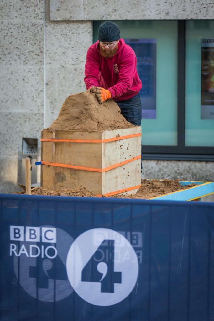 Jamie compacting the sand for the Radio 4 sand sculpture