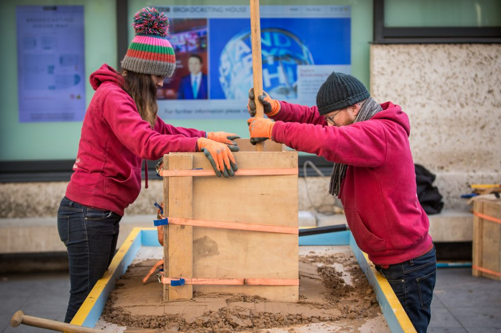 Working on the sand sculpture for Radio 4 Desert Island Discs. Image credit Ben Grubb