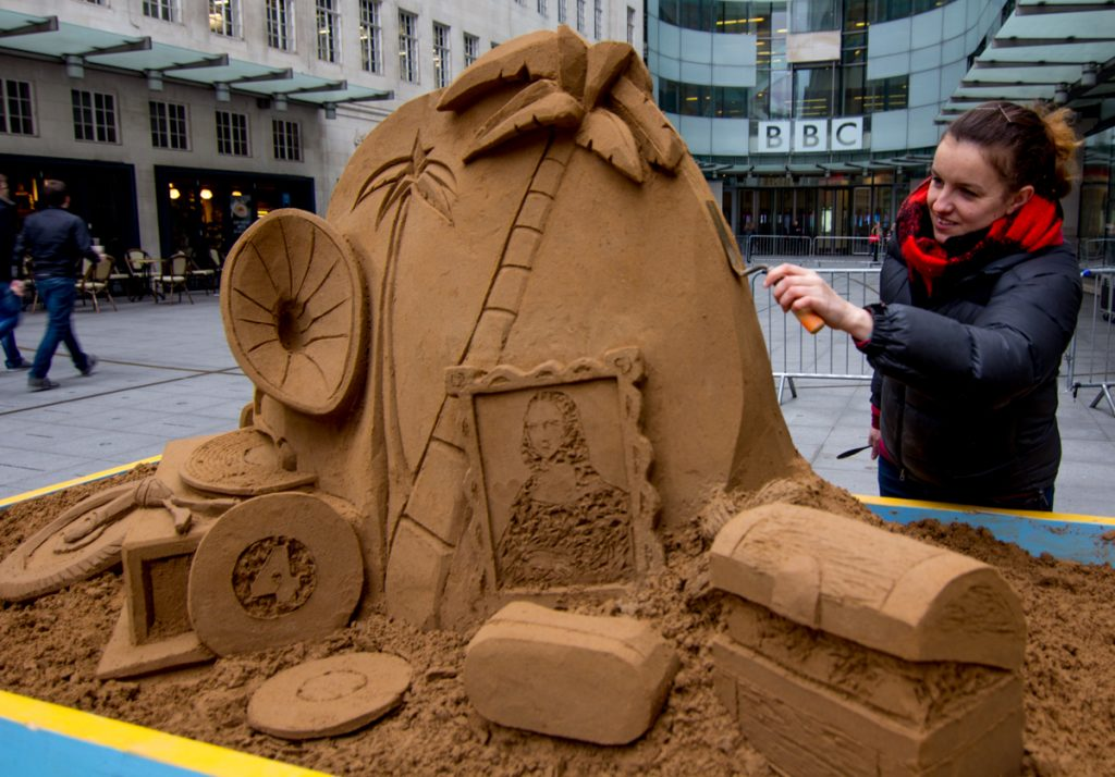 Claire working on the sand sculpture for Desert Island Discs