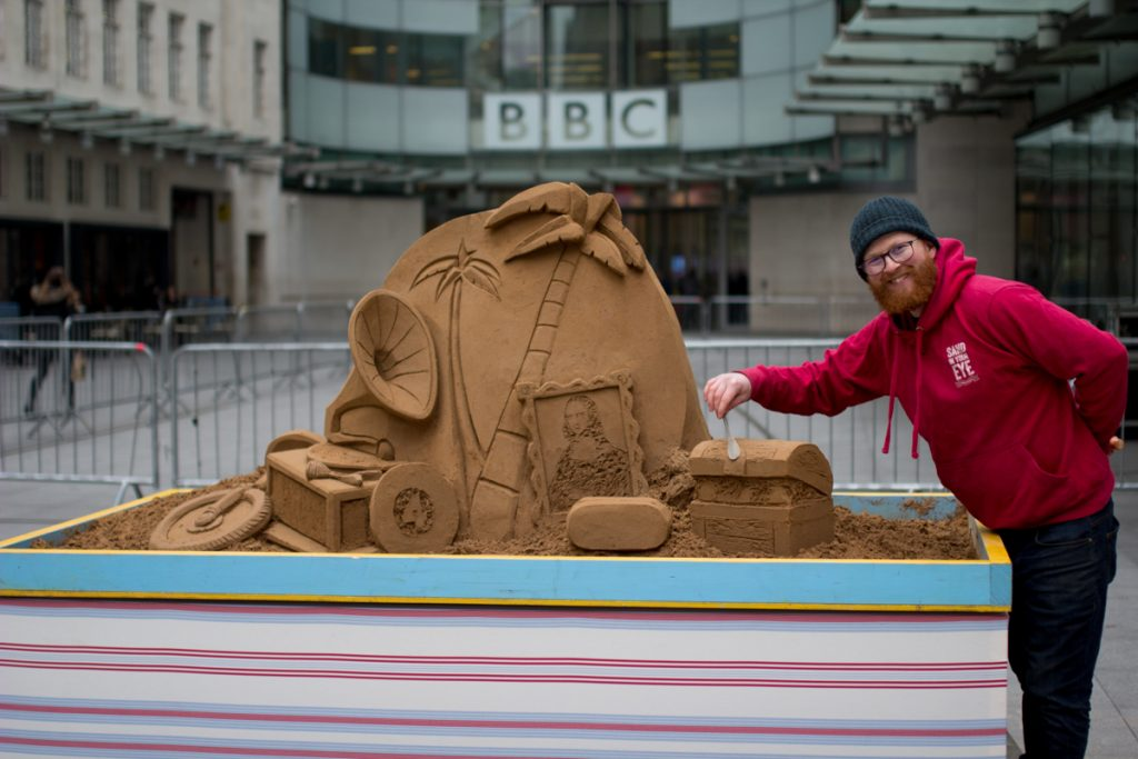 Jamie with his Desert Island Discs sand sculpture