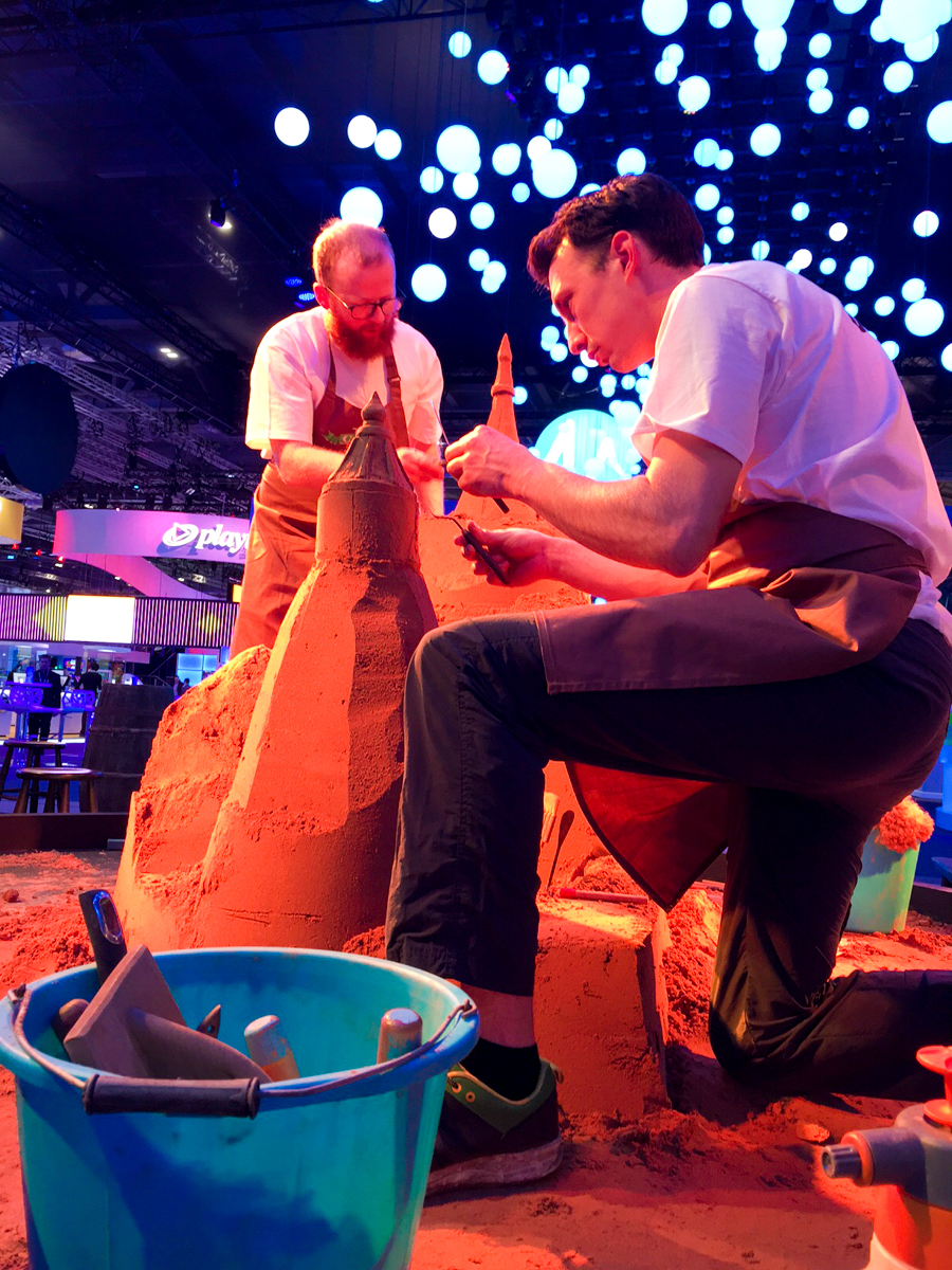 Jamie and Tom sand sculpting at the trade show event