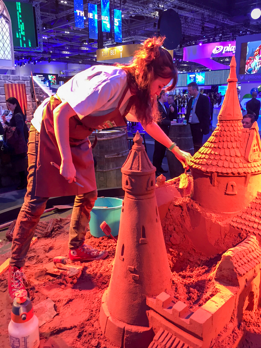 Claire sand sculpting at the one day pop up corporate event