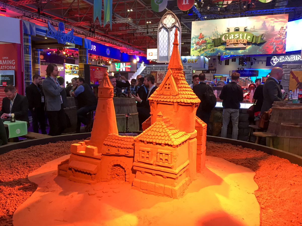 Microgaming finished sand sculpture