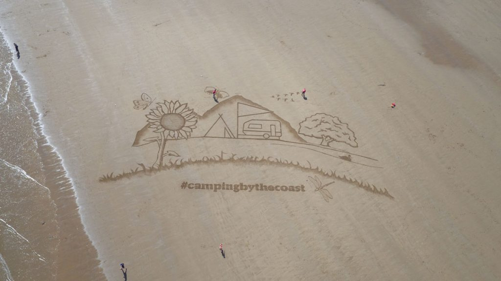 beach art sand art camping and caravaning club