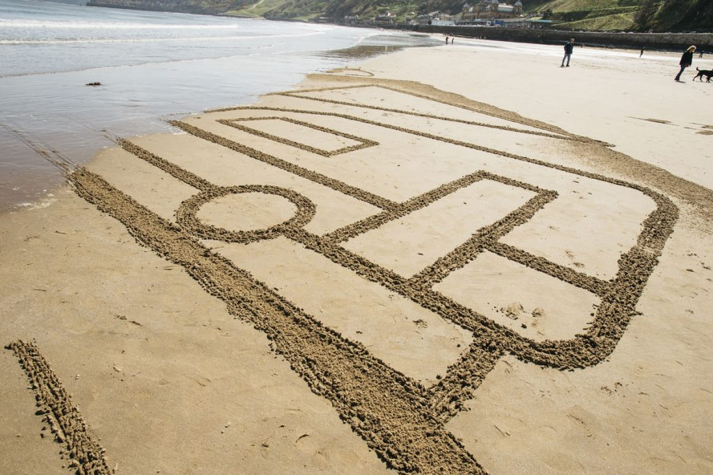 giant sand drawing beach art uk beaches