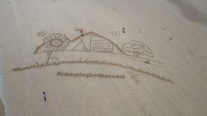sand_drawing_yorkshire_sand artists giant beach art