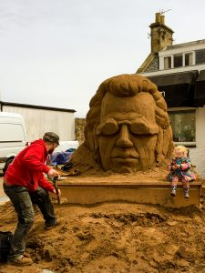 figurative sand sculptures sand in your eye