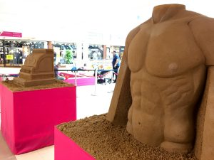 torso male sand sculpture hull