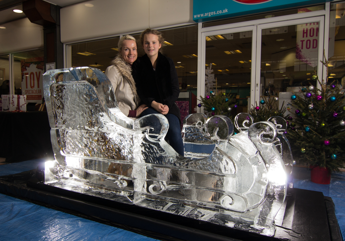 Posing on the Ice Sculpture