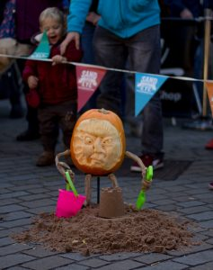 Pumpkin carving festival sand in your eye