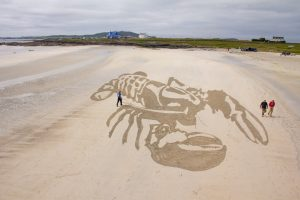 anamorphic sand drawing beach tiree
