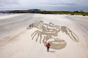 anamorphic sand drawing tiree music festival