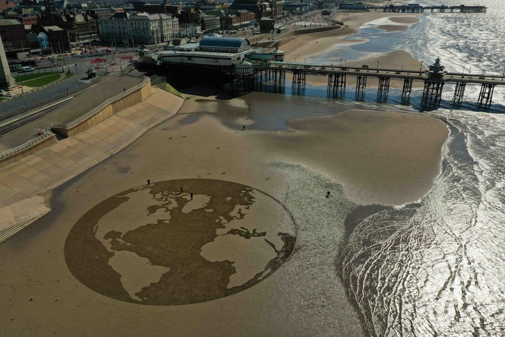 sand drawing Blackpool beach