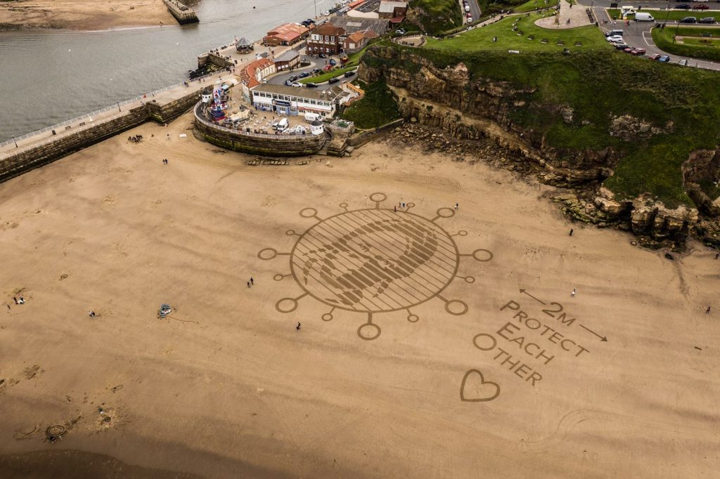 Social distancing sand drawing whitby