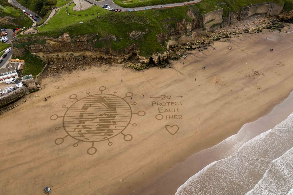 corona virus sand drawing