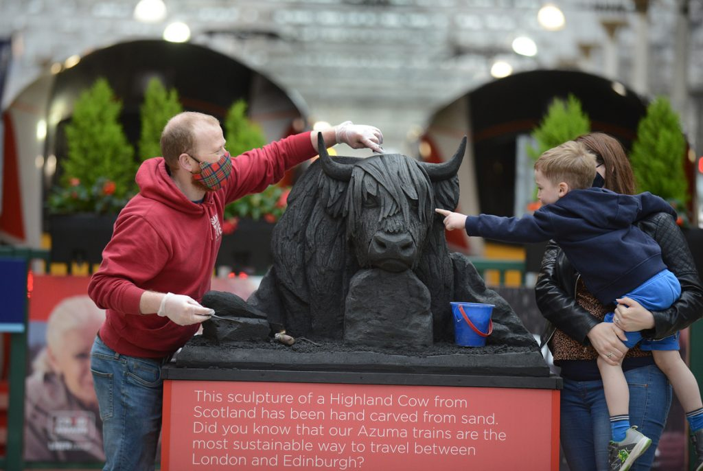 Sculpture of Tyne Bridge unveiled at Newcastle Central Station as part of a series highlighting the environmental credentials of train travel as staycations boom.